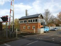 Level crossing and signal box at Moreton-on-Lugg north of Hereford on the Shrewsbury & Hereford Joint line in November 2008. Note the telegraph pole behind the box still retaining its extensive array of cross arms and insulators.<br> <br><br>[John McIntyre&nbsp;18/11/2008]