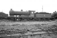 Reid ex-NBR <I>Scott</I> class 4-4-0 no 62442 <I>Simon Glover</I> stands at Thornton in July 1958. Officially withdrawn by BR that year, the locomotive was cut up in February of 1960 at Motherwell Machinery & Scrap, Wishaw.<br> <br><br>[Robin Barbour Collection (Courtesy Bruce McCartney)&nbsp;29/07/1958]