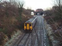 View eastwards as 156471 approaches Poulton No 3 box and station from Blackpool North. The station booking office stands on the bridge, overlooking the junction with the disused Burn Naze/Fleetwood line.<br><br>[Mark Bartlett&nbsp;03/12/2008]