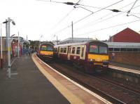 A pair of 320s pass at Partick on 30 August as reconstruction and modernisation work continues on this important west side rail/bus/Subway interchange.<br><br>[David Panton&nbsp;30/08/2008]