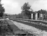 <I>Scene of the demo</I>. When the Accrington line closed and the Bacup line was cut back to Rawtenstall on 5th December 1966 the service at Summerseat was drastically cut mid-timetable, losing around 75% of its weekday trains. The incensed locals held a demonstration and blockade at the station and several arrests were made.  Services were still pruned though but the line lingered on for a further few years. However, as can be seen, buildings were demolished and the replacement shelter was less than basic and clearly not intended to last. Note however the 2, 4 and 6 <I>Car Stop</I> signs still in place on the disused down platform in this view towards Ramsbottom. [See image 21959] for a modern day 'Then and Now' comparison.<br><br>[W A Camwell Collection (Courtesy Mark Bartlett)&nbsp;27/05/1972]