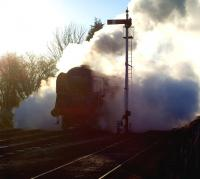 Reminiscent of a David Shepherd painting perhaps... the artist's BR 9F 2-10-0 no 92203 <I>Black Prince</I> emerging from the smoke and steam at Winchcombe on the Gloucestershire Warwickshire Railway on 7 December 2008.<br><br>[Peter Todd&nbsp;07/12/2008]