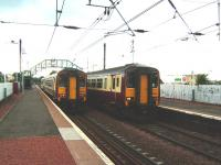 View west from the platform at Slateford on 30 July as a slightly late running 1532 for Glasgow Central passes the 1534 for Edinburgh Waverley.<br><br>[David Panton&nbsp;30/07/2008]