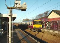 318 255 pulls into Irvine station on 10 December 2008 with a Glasgow Central - Ayr service.<br><br>[David Panton&nbsp;10/12/2008]