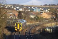 158 725 with a Fife Outer Circle service passes the site of Touch South Junction on 11 December 2008. This is the point where the direct line from the south branched off to the left to reach Dunfermline Upper station.<br><br>[Bill Roberton&nbsp;11/12/2008]