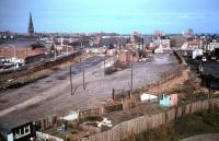 Remains of the 1847 Newcastle and North Shields Railway terminus at Tynemouth (later a goods yard), photographed in 1984, soon after the last of the track had been lifted. In the right background is the site of Tynemouth Priory, burial place of three of the Kings of Northumbria. [See image 30525] <br><br>[Colin Alexander&nbsp;//1984]