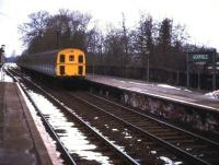 A <I>Thumper</I> DEMU arriving at a snowy Uckfield in 1974. [The original Lewes & Uckfield station was replaced by new station in 1991.]<br><br>[Ian Dinmore&nbsp;//1974]