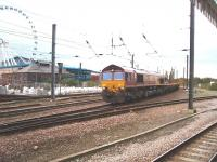 An infrastructure train heads south into York behind EWS 66238, viewed from the Scarborough platform. The National Railway Museum, and the Yorkshire Wheel in the museum grounds, can be seen behind the train. <br><br>[Mark Bartlett&nbsp;11/10/2008]