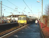 A Glasgow Central - Ayr service pulls into Kilwinning platform 4 on 10 December 2008, with 318 269 at the head of a 6-car train.<br><br>[David Panton&nbsp;10/12/2008]