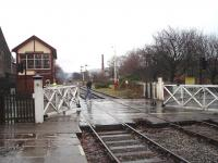 Full credit to the East Lancashire Railway for their restoration at Ramsbottom, which includes reinstating the wheel operated level crossing gate mechanism.  Here the gates are opened to road traffic after the DMU has departed for Rawtenstall.<br><br>[Mark Bartlett&nbsp;13/12/2008]