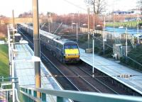An ECML Kings Cross - Edinburgh Waverley - Glasgow Central GNER service speeds north through Wallyford station on a bright and chilly 12 January 2003.<br><br>[John Furnevel&nbsp;12/01/2003]
