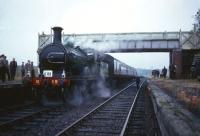A Branch Line Society Railtour stops at Lanark Racecourse Halt on 16 October 1965 (a year after official closure) behind ex-Great North of Scotland Railway 4-4-0 No 49 <I>Gordon Highlander</I>. The locomotive is going towards Ponfeigh and the junction signals for Smyllum can be seen in the background.<br><br>[Robin Barbour Collection (Courtesy Bruce McCartney)&nbsp;16/10/1965]