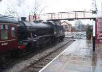 <I>The Great Marquess,</I> on ELR <I>Santa Special</I> duties, waits by the level crossing at Ramsbottom. In the early 1960s Ramsbottom was very busy with passenger and freight trains and the signal box here was operated continuously seven days a week, apart from a short period in the small hours of Monday mornings. 61994 returned to Thornton after this weekend's ELR roster.<br><br>[Mark Bartlett&nbsp;13/12/2008]