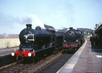Class J37 no 64602 stands at Anstruther with a railtour in the early 60s as B1 61330 runs into the station with a southbound train. Anstruther closed to passengers in September 1965. The B1 was withdrawn in 1966 and the J37 a year later.<br><br>[Robin Barbour Collection (Courtesy Bruce McCartney)&nbsp;//]