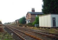 Haxby closed in 1930 but the station building is still used as a house, standing alongside the York to Scarborough line. This view is from the level crossing towards York. <br><br>[Mark Bartlett&nbsp;15/12/2008]