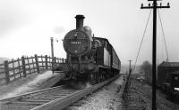 L&YR 2-4-2T 50651, with a 26D Bury shedplate on its smokebox, calls at the small Woodhill Road Halt on its way to Holcombe Brook on the last day of services. Conductor rails still in place alongside the line. (Does anyone have pictures of the electric trains on this branch?) I visited this site in December 2008 and found that not only has the station gone but also the embankment has made way for housing too, with the spoil apparently moved up the hill to fill in Brandlesholme Road cutting [see image 21238], where houses were also being built. Print credited to N R Knight. <br><br>[W A Camwell Collection (Courtesy Mark Bartlett)&nbsp;04/05/1952]