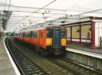 Glasgow Central - Ayr service at Troon in July 1997 formed by 318 254.<br><br>[David Panton&nbsp;/07/1997]