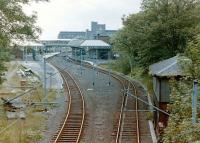 View south over the 1882 Tynemouth station in the early 1980s, with the boarded up North signal box on the right and the 4 through roads replaced by 2 realigned tracks for the new Metro. [see image 30600 for the view nearly thirty years on]<br> <br><br>[Colin Alexander&nbsp;//]