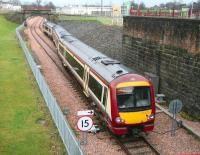 The 1318 from Glasgow Queen Street takes the platform line at Alloa Station Junction on 22 December 2008.<br><br>[John Furnevel&nbsp;22/12/2008]
