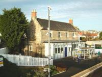 View north showing the main station building at Kinghorn on 20 December 2008. Like all other E&N stations on the 1847 Burntisland to Cupar line (apart from the original Burntisland itself when it was a ferry terminal) Kinghorn had a flat canopy supported by closely-spaced plain columns.� This colonnade has since been boxed in with wood and the ticket window moved to what was the outside wall.� An ornate lamp-bracket attached to one column was cut round and survives, most of it indoors.� Other surviving buildings from 1846/7 are Markinch, Ladybank, Springfield and Cupar. Springfield, though long a private house, is closest to how Kinghorn would originally have looked. <br> <br><br>[David Panton&nbsp;20/12/2008]