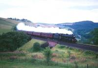<I>Jubilee</I> 4-6-0 no 45593 <I>Kolhapur</I> heads north through Drumlanrig Gorge between Enterkinfoot and Sanquhar in the 1960s. [See image 32746]<br><br>[Robin Barbour Collection (Courtesy Bruce McCartney)&nbsp;//]
