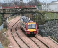 A First ScotRail service arriving from Glasgow Queen Street passes east under the bridge that once carried the 1760s Alloa Wagonway as it runs into the platform at Alloa station on 22 December 2008. <br><br>[John Furnevel&nbsp;/12/2008]