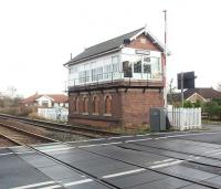 Although closed for nearly 80 years the intermediate stations between York and Malton have lots of infrastructure. In many cases this includes station buildings, platforms and mechanical signal boxes.  The impressive box at Strensall still controls the level crossing by the former station, albeit by electrical rather than mechanical means and colour light signals in this case. View towards Malton.<br><br>[Mark Bartlett&nbsp;15/12/2008]