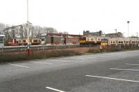 Looking north towards Airdrie station from the car park on Boxing Day 2008. On the left the 1208 Drumgelloch - Helensburgh service has just arrived at the platform, while in the bay in the centre an Aidrie - Balloch train is next out. The train on the far right is standing in the stabling siding. The gentleman striding purposefully along the platform is hurrying to advise me that taking photographs of Airdrie station is illegal. After responding that I had been unaware of this, thanking him for the information, apologising for any difficulties I may have caused and wishing him a happy and prosperous 2009, I left.<br> <br><br>[John Furnevel&nbsp;26/12/2008]