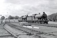 Scene at Roxburgh, the remote junction of the lines from Jedburgh and Kelso, on 9 July 1961. J37 0-6-0 no  64624 and D34 4-4-0 no 256 <I>Glen Douglas</I> are in the process of running round their train, the RCTS <I>Borders Railtour</I> from Leeds City, following a trip along the Jedburgh branch.<br> <br><br>[Robin Barbour Collection (Courtesy Bruce McCartney)&nbsp;09/07/1961]