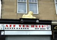 The office/shop once used by coal merchant John Lyon in Glasgow Road, Paisley, (just round the corner from the former Paisley East yard)�photographed�in December 2008 complete with�classical Lion <I>couchant</I> (one of a pair) still in place above the shop front.�The�second member of the pair [see image 21161], stood in the John Lyon coal yard�alongside Hawkhead station, some�44 years earlier.<br> <br><br>[Colin Miller&nbsp;25/12/2008]