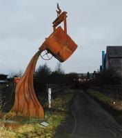 Pouring metal sculpture just to the west of the former triangular junction at Bathgate on the Airdrie and Morningside (Lanarks) routes. View looks to Bathgate.<br><br>[Ewan Crawford&nbsp;26/12/2008]
