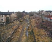 Remains of the 1862 station at Caldercruix viewed from the road bridge looking towards Drumgelloch on 26 December 2008. In the original plan, the second Caldercruix station was to be built on a new site located on the western edge of the village but, due to unforseen environmental problems, that plan has had to be changed and the new station will now be built here. [See image 33163]<br><br>[John Furnevel&nbsp;26/12/2008]