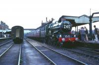 An Ian Allan Railtour stands at platform 2 at Worcester Shrub Hill on 8 August 1965. The special had arrived from Paddington via Oxford and returned via Swindon and the GWR main line, hauled by preserved 4079 <I>Pendennis Castle</I> throughout. <br><br>[Robin Barbour Collection (Courtesy Bruce McCartney)&nbsp;08/08/1965]