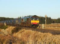 DRS 66428 southbound near Moy with a train of 24 containers for Grangemouth on 30th December 2008.<br><br>[John Gray&nbsp;30/12/2008]