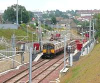 View south over Larkhall station from Raploch Street bridge in August 2006 with a train about to leave for Dalmuir. At this point the station had been open for nearly 9 months.<br><br>[John Furnevel&nbsp;14/08/2006]