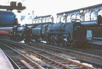 Scene at Carlisle in the mid 1960s with <I>Britannia</I> Pacific 70041 <I>Sir John Moore</I> (minus nameplates) with a train at platform 4 and Ivatt 2MT 2-6-0 no 46426 on the centre road.  <br><br>[Robin Barbour Collection (Courtesy Bruce McCartney)&nbsp;//]