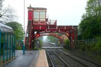 View east along the staggered platforms at Wylam, on the Newcastle & Carlisle line, looking over Station Road level crossing on a Sunday morning in May 2006. There has been a station here since March 1835. Wylam is claimed by many to be <I>...'the oldest railway station in the world, with original buildings, still in constant use'</I>.  <br><br>[John Furnevel&nbsp;07/05/2006]