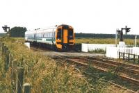 158 716 speeds north over Bow of Fife level crossing in July 2002.<br><br>[David Panton&nbsp;/07/2002]