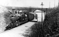 Immediately after the steam push pull trains had taken over from the electric trains on the branch L&YR 2-4-2T 50829 pulls in to Brandlesholme Road Halt, serving a suburb of Bury, on the 4.16pm from Bury Bolton Street to Holcombe Brook. Electric operation officially finished three days later so this would have been one of the first steam operated services. Brandlesholme Road passed over the bridge and is still the main road from Bury out to Holcombe Brook.