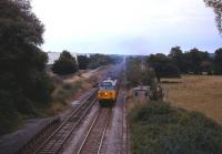 A class 50 is about to take a Waterloo to Exeter service through the closed (1966) station at Dinton, west of Salisbury, in May 1985.<br><br>[John McIntyre&nbsp;/05/1985]