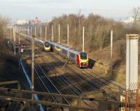 A southbound 5 car Virgin Voyager passes a northbound Pendolino just south of Preston station on 6 January 2009.<br> <br><br>[John McIntyre&nbsp;06/01/2009]