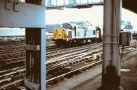 A class 37 takes empty stock through Newcastle Central in 1984.<br><br>[Colin Alexander&nbsp;//1984]