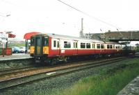 318 257 pulls into Ardrossan South Beach in June 1999 with a Glasgow Central service. <br><br>[David Panton&nbsp;/06/1999]
