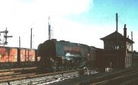 Stanier <I>Coronation</I> Pacific no 46247 <I>City of Liverpool</I> stands alongside Beattock North signal box with the heavy 10am Euston - Perth on 15 April 1963 ready to take on banking assistance.   <br> <br><br>[Robin Barbour collection (Courtesy Bruce McCartney)&nbsp;15/04/1963]