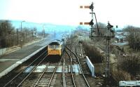 A class 47 approaches Haltwhistle with a Carlisle bound train in 1984. On the right is the remaining stub of the former Alston branch climbing towards the South Tyne viaduct.<br><br>[Colin Alexander&nbsp;//1984]