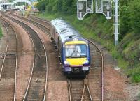 ScotRail 170459 runs downhill from Dalmeny station on 26 June 2008 with a Fife Circle train returning to Waverley. The yard visible in the background is used to hold equipment and materials for use in connection with maintenance of the Forth Bridge [see image 54772].<br><br>[John Furnevel&nbsp;26/06/2008]