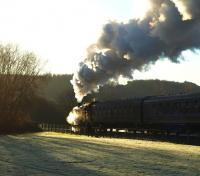 View into the winter sun showing 80105 at the head of <I>Santa's Polar Express</I> from SRPS Boness on 6 December 2008.<br><br>[Brian Forbes&nbsp;06/12/2008]