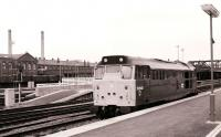 Signal check at Doncaster in February 1981 as a class 31 is held at the platform<br><br>[Peter Todd&nbsp;07/02/1981]