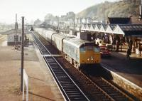 An Inverness - Kyle of Lochalsh train runs into Dingwall station in 1970. <br><br>[Colin Miller&nbsp;//1970]
