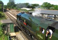 Rebuilt Bulleid West Country Pacific 34016 <I>Bodmin</I> awaits the all-clear from the guard on 9 August 2005 before setting off from Medstead and Four Marks Station on the Mid Hants Railway.<br> <br><br>[Peter Todd&nbsp;09/08/2005]